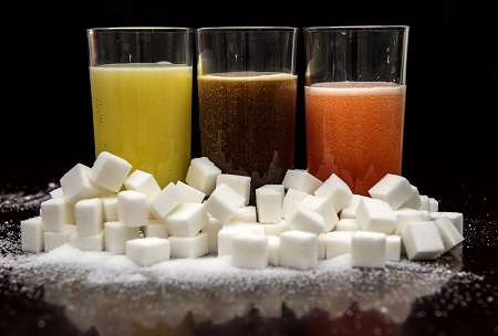 (carbonated drinks surrounded by sugar cubes as soft drink companies should set global sugar reduction targets to stop a worldwide obesity epidemic set to reach 1.12 billion people by 2030, a UK charity has urged Image/PA)